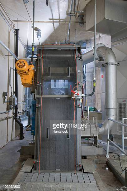 electric motor controls and air duct and ionizer in screen system of pump station - air pump stock photos and pictures