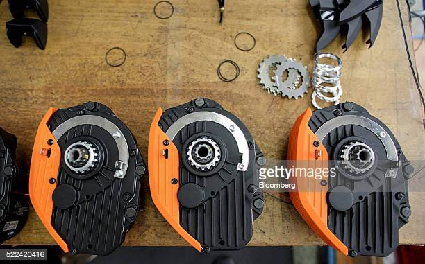 Electric motor drive units manufactured by Robert Bosch GmbH sit on a workbench ready to be mounted on electronic bikes inside the KTM Fahrrad GmbH...