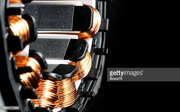 electric motor stator winding and stack close-up - electric motor stock photos and pictures