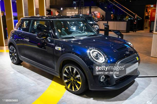 Electric or Mini Cooper SE compact all electric retro design car on display at Brussels Expo on JANUARY 09 2020 in Brussels Belgium The MINI Electric...