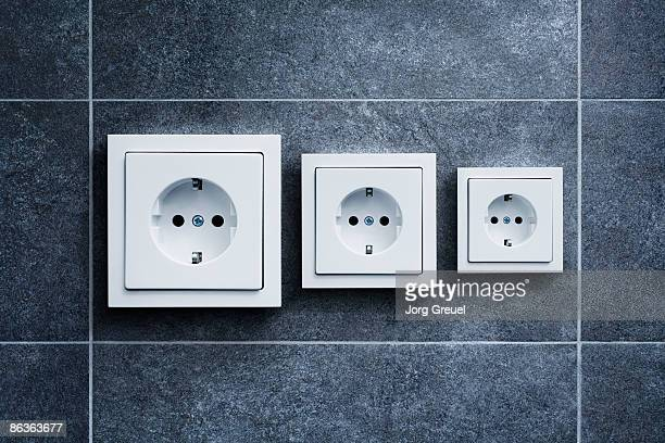 electric outlets (german) in different sizes - tomada - fotografias e filmes do acervo