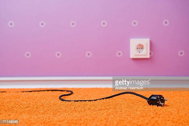 electric plug and socket (focus on electric plug) - things that go together stock pictures, royalty-free photos & images