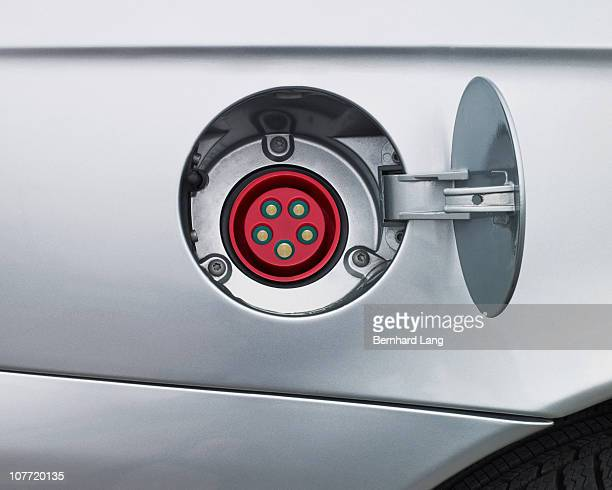 electric plug for electric car, close up - gas tank stock photos and pictures