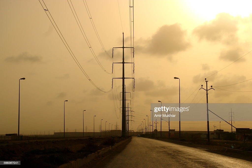 Electric poles and wires : Stock Photo