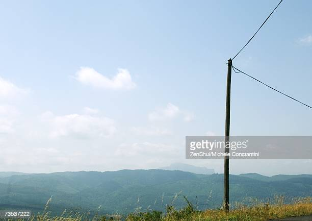 Electric post, mountainous landscape in background