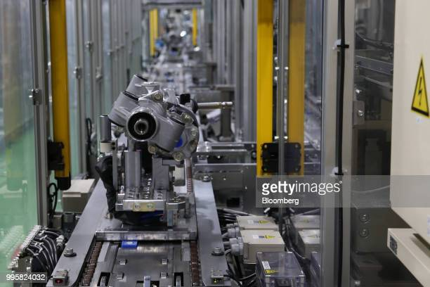 Electric power steering gears sit on the production line at the Jtekt Corp Hanazono plant in Okazaki Aichi Prefecture Japan on Tuesday July 10 2018...