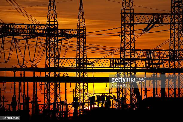 Electric power towers and lines in a sunset