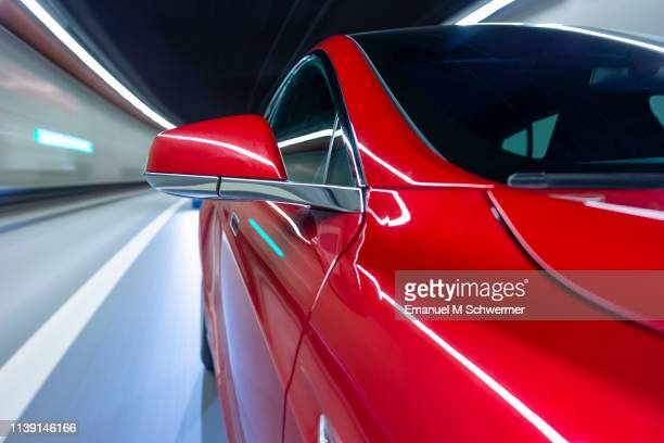 electric powered driverless car drives through highway tunnel - driverless car stock pictures, royalty-free photos & images