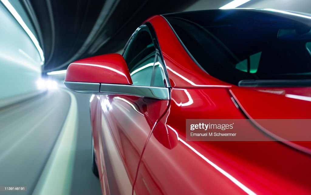 electric powered driverless car drives through tunnel : Stock Photo