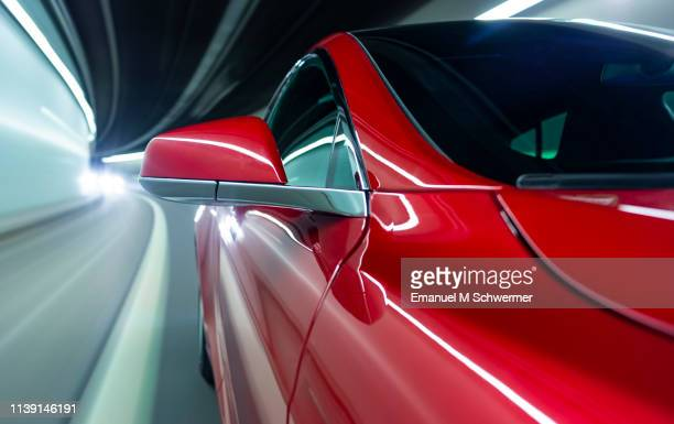 electric powered driverless car drives through tunnel - sports car stock pictures, royalty-free photos & images