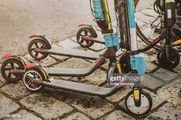 electric push scooter for public use - mobility scooter stock photos and pictures