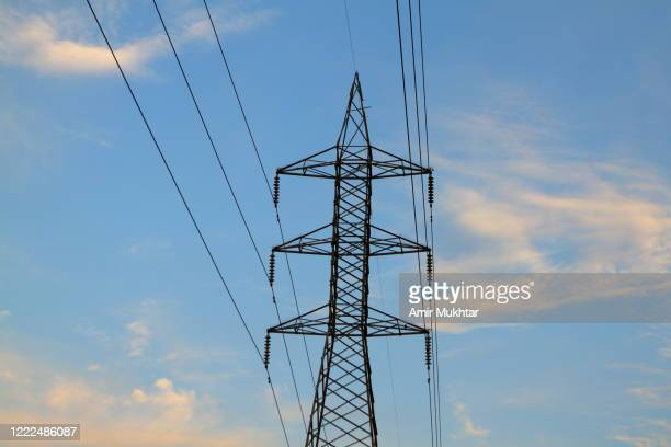 electric pylon against sky. - pakistan stock pictures, royalty-free photos & images