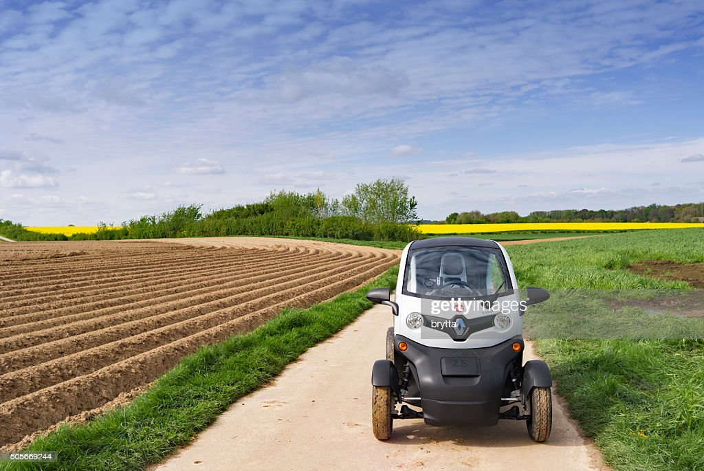 Electric Renault Twizy 45 driving on  rural road in Belgium : Stock Photo