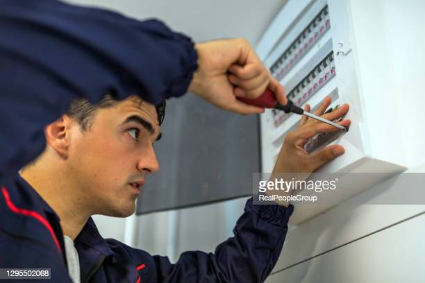 electric residential fuses box check by caucasian electrician. - electrical panel box stock pictures, royalty-free photos & images