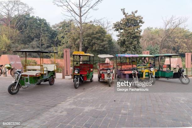 electric rickshaw near taj mahal, india - rickshaw stock photos and pictures