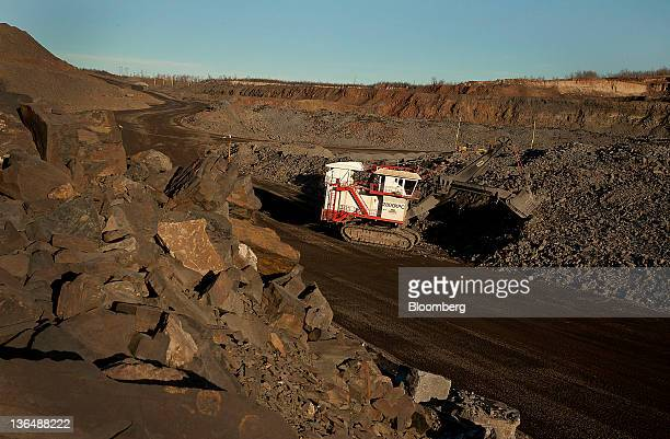 A PH electric rope shovel digs taconite out of a pit mine at the Hibbing Taconite Co pellet manufacturing plant operated by Cliff's Natural Resources...
