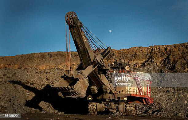 A PH electric rope shovel works at an open pit mine at the Hibbing Taconite Co pellet manufacturing plant operated by Cliff's Natural Resources Inc...