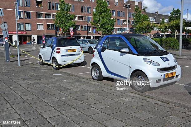 Electric Smart Fortwo cars on the parking and charging point