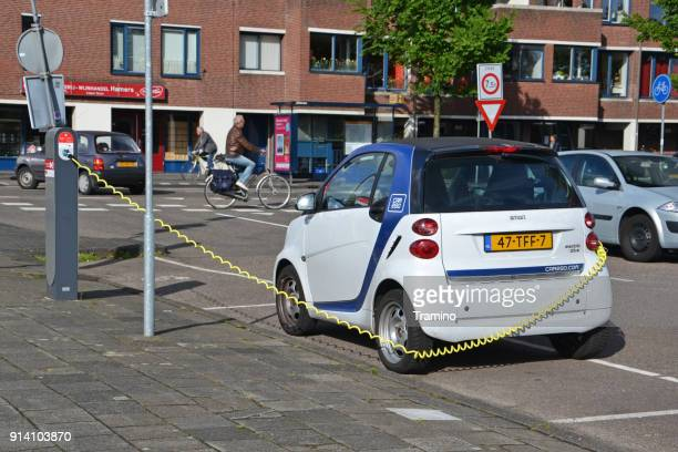 Electric Smart Fortwo on the parking and charging point