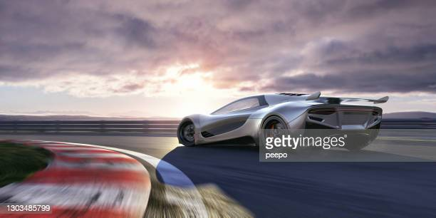 electric sports car moving at high speed around racetrack corner - motorsport stock pictures, royalty-free photos & images