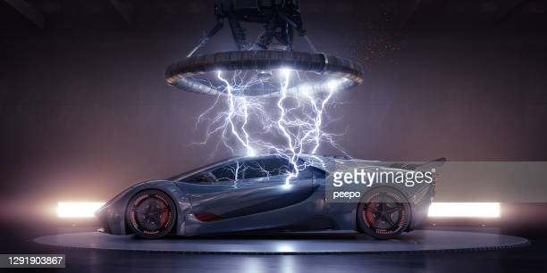 electric sports car struck by electrical lightning from coil - lightning stock pictures, royalty-free photos & images
