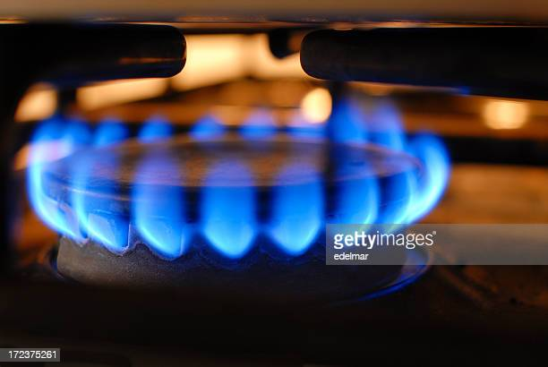 Electric stove on high heat burning blue flames