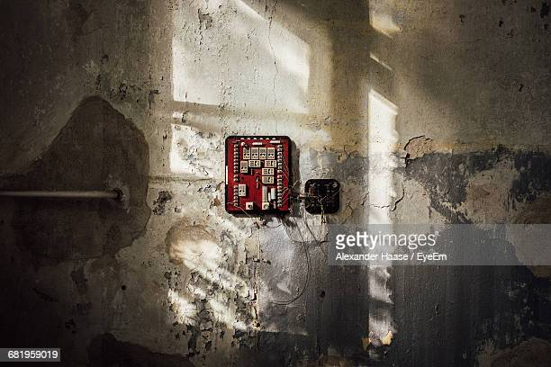 electric switch board on damaged wall - köpenick stock pictures, royalty-free photos & images