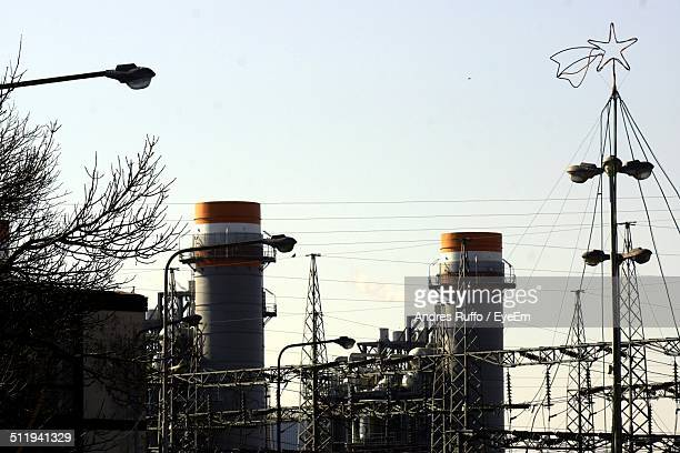 electric thermo pilar against cloudy sky - andres ruffo stock pictures, royalty-free photos & images