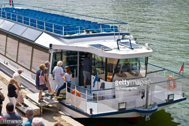electric tour boat docked in lyon, france - quayside stock pictures, royalty-free photos & images