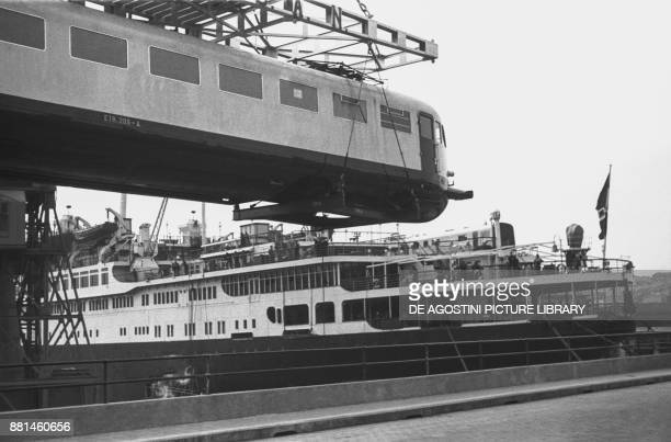 Electric train being loaded onto the SS Rex January 25 Genoa port Italy 20th century