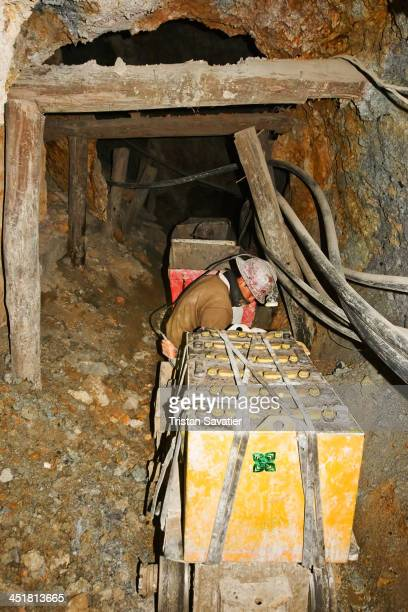 Electric trolley carrying ore out of the old Candelaria silver mine in Potosi . The yellow boxes are the battery packs powering the trolley. The...