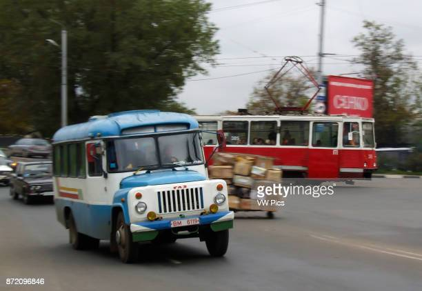 Electric trolley in traffic in Vitebsk Belarus A public bus is in the foreground The slow shutter speed produces a blurred effect conveying a sense...