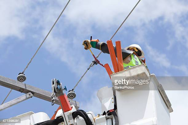 electric utility lineman cuts jumper wire connection - power line stock pictures, royalty-free photos & images