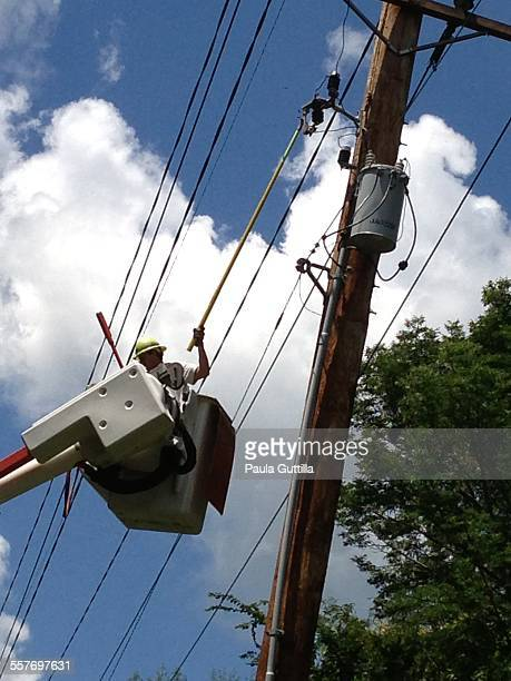 Electric utility worker turning the power back on after a 6/30/14 Microburst hit the area Utica IL