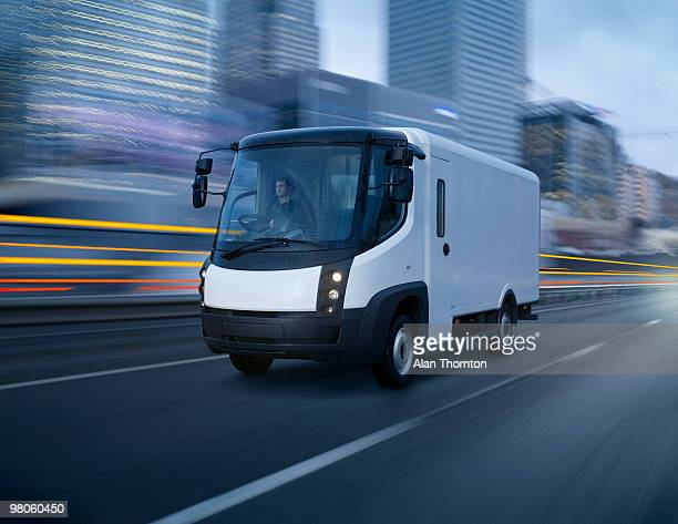 electric van in city - electric car stock pictures, royalty-free photos & images