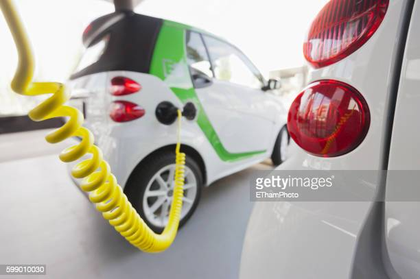 Electric vehicle charging at charge station