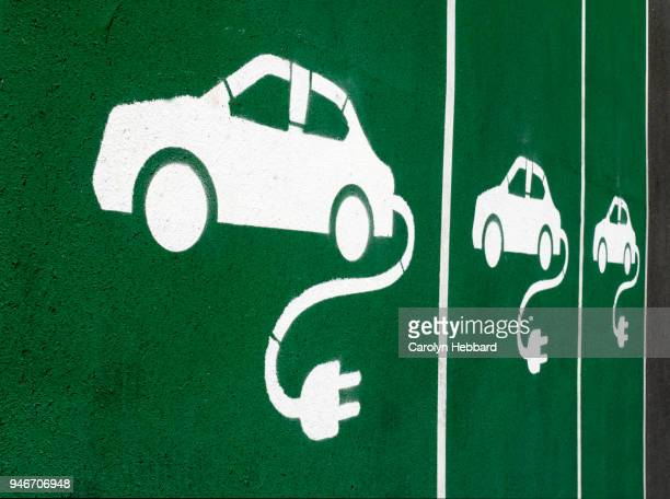 electric vehicle charging bay symbol - electric vehicle charging station stock photos and pictures
