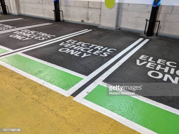 electric vehicle charging - hybrid car stock photos and pictures