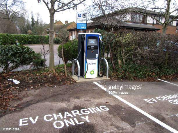 Electric Vehicle charging point seen at Travelodge hotel car park. UK car sales hit 28-year low in 2020, but the Electric Vehicle market has grown...