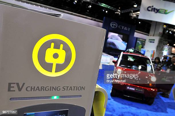 T electric vehicle charging station is displayed during the press preview for the world automotive media North American International Auto Show at...