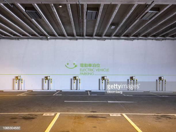 Electric vehicle charging stations stand at a parking lot in Hong Kong China on Friday Nov 23 2018 Hong Kong's administration scrapped tax incentives...
