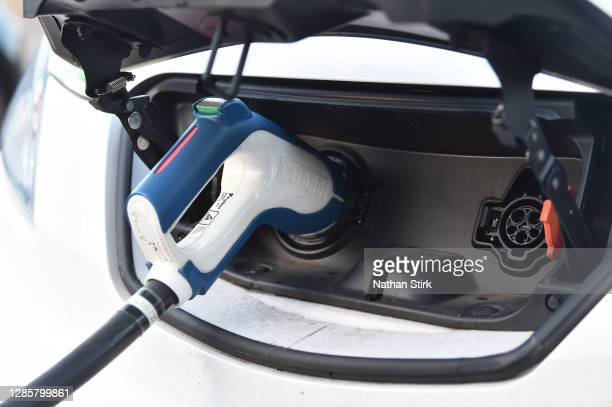 Electric vehicle is seen at a charging pod point on November 15, 2020 in Stoke-On-Trent, England. In a 10-point environmental plan to be announced...