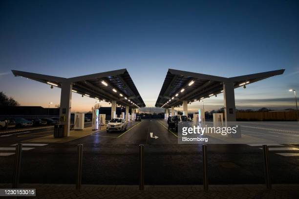 Electric vehicles at charging stations at Gridserve's new electric forecourt in Braintree, U.K., on Tuesday, Dec. 15, 2020. The first all-electric...