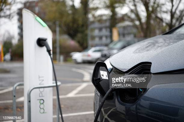 Electric vehicles charge at a charging station in east London on November 18, 2020. - Britain will ban petrol and diesel vehicle sales from 2030 as...