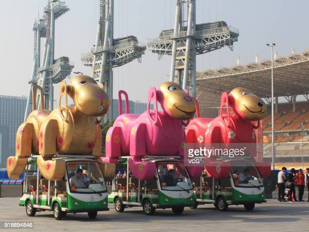 Electric vehicles is decorated with dog models at a square on February 17 2018 in Guangzhou China The 2018 Chinese New Year which is the year of the...