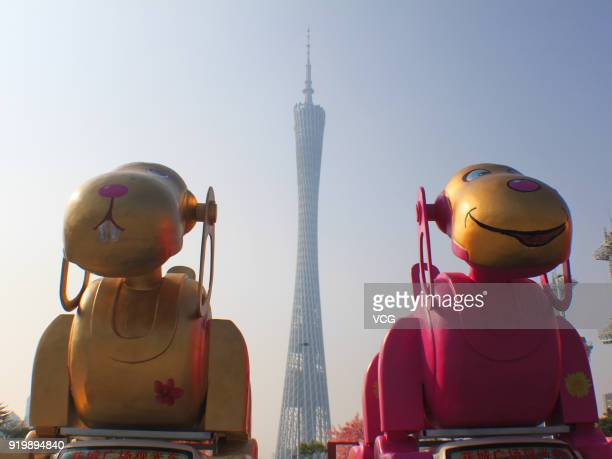 Electric vehicles is decorated with dog models in front of Canton Tower on February 17 2018 in Guangzhou China The 2018 Chinese New Year which is the...
