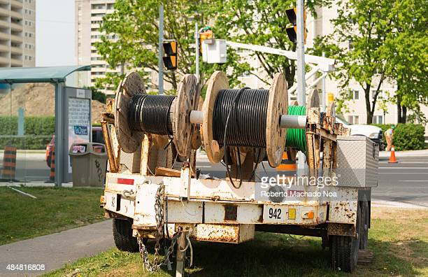 Electric wires in trailer large coils of cables on the streets Electric workers install a new traffic lights system in Victoria Park Ave and...