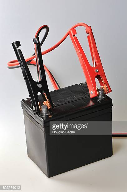 Electrical Booster Cables on a Vehicle Battery