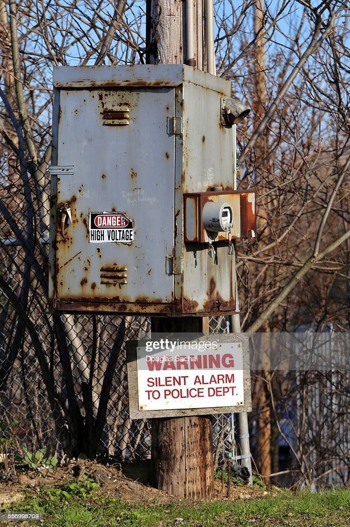 Electrical box hanging on a power pole : Stock Photo