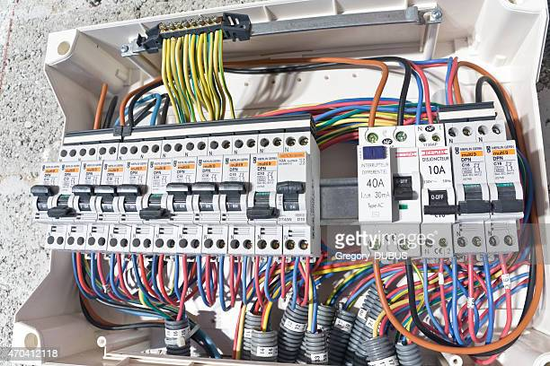 electrical circuit breaker box installation - fuse stock photos and pictures